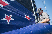 Emirates Team New Zealand sailors Blair Tuke and Glenn Ashby guide the main sail up before racing on day two of the Extreme Sailing Series at Nice. 3/10/2014