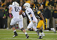 October 20 2012: Penn State Nittany Lions quarterback Matthew McGloin (11) scrambles during the first half of the NCAA football game between the Penn State Nittany Lions and the Iowa Hawkeyes at Kinnick Stadium in Iowa City, Iowa on Saturday October 20, 2012. Penn State defeated Iowa 38-14.