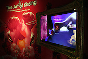 A section is dedicated to the art of kissing at Amora, the Academy of Sex and Relationships, on Tuesday, April 17, 2007, in London, UK. The world's first visitor attraction dedicated to love, sex and relationships opens its door officially tomorrow (18th of April 2007) in Piccadilly. The permanent interactive attraction, Amora, expects to draw over half a million, 18+ visitors in the first year and fuses entertainment, excitement and education in a unique powerful sensory experience. With seven zones covering every aspect of relationships from first filtrations and dating to fantasy and fetish. Visitors can explore the science of attraction - what they find attractive and why, learn how to enhance their skills and even create what their perfect partner might look like. Male and female models help demystify erogenous zones, G-spot and prostate, while insights and technique tips are offered on various topics. Sexual awareness and well-being are also covered thoroughly. **Italy Out**..