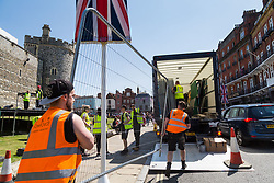 Workers dismantle a temporary studio outside Windsor Castle on the day following the wedding of Prince Harry to Meghan Markle in Windsor, Berkshire. WINDSOR, May 20 2018.