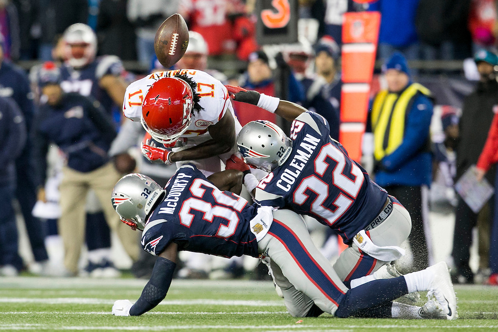 New England Patriots defensive backs Justin Coleman (22) and Devin McCourty (32) break up a pass intended for Kansas City Chiefs wide receiver Chris Conley (17) in the fourth quarter of the AFC Divisional Playoff game at Gillette Stadium in Foxborough, Massachusetts on January 16, 2016. The Patriots defeated the Chiefs, 27-20.    Photo by Kelvin Ma/ UPI