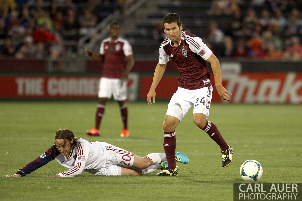 August 3rd, 2013 - Colorado Rapids midfielder Nathan Sturgis (24) steals the ball from Real Salt Lake midfielder Ned Grabavoy (20) in the first half of action in the Major League Soccer match between Real Salt Lake and the Colorado Rapids at Dick's Sporting Goods Park in Commerce City, CO