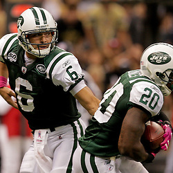 2009 October 04: New York Jets running back Thomas Jones (20) gets a handoff from quarterback Mark Sanchez (6) during a 24-10 win by the New Orleans Saints over the New York Jets at the Louisiana Superdome in New Orleans, Louisiana.