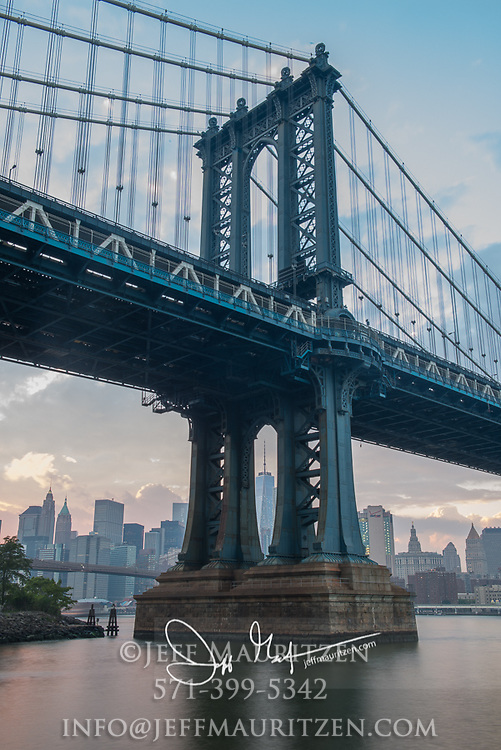 Manhattan Bridge is a suspension bridge that spans the East River and connects Brooklyn with Manhattan, NYC.