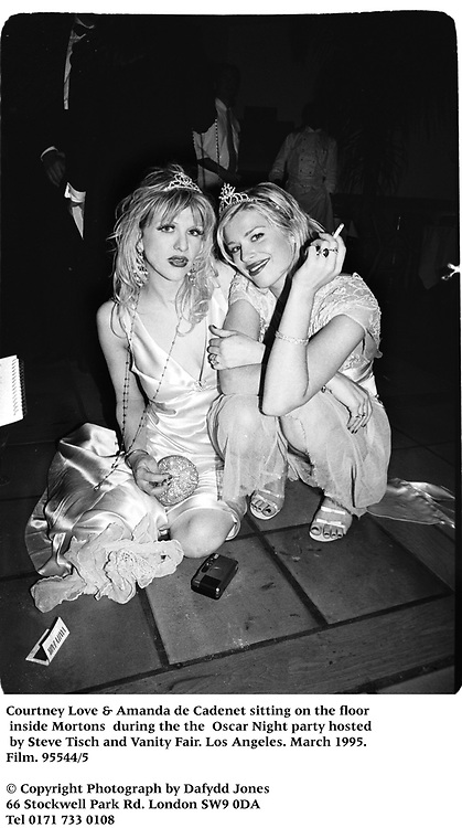 Courtney Love &amp; Amanda de Cadenet sitting on the floor inside Mortons  during the the  Oscar Night party hosted by Steve Tisch and Vanity Fair. Los Angeles. March 1995. 95544/5<br /> &copy; Copyright Photograph by Dafydd Jones<br /> 66 Stockwell Park Rd. London SW9 0DA<br /> Tel 0171 733 0108