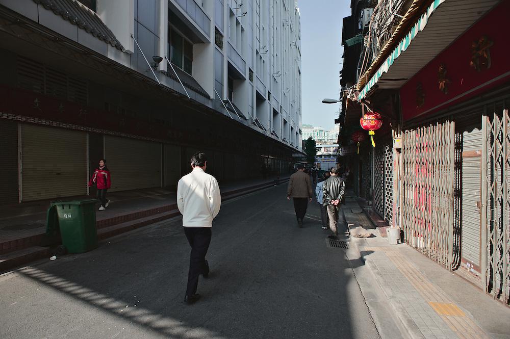 Men walking down street, Guangzhou, China