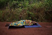 A woman lies on the road dying from a gunshot wound to the head close to the village of Dekoa after the armed peacekeeping convoy from the African Union operation in CAR (MISCA) she was travelling in came under attack by anti Balaka militiamen, as it travelled towards the towns of Kabo and Sido in the north on the border with Chad  April 28, 2014.