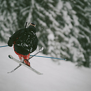 Owne Dudley skis off into the trees during a blizzard at Mount Baker Ski Area.