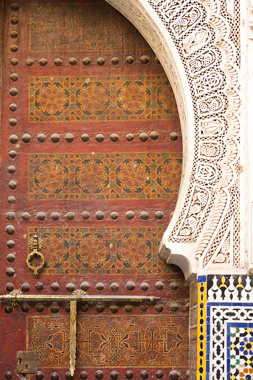 Old Moroccan doorway with intricately painted geomtric patterns and designs, Fez Medina, Morocco, 2015-12-16.<br />