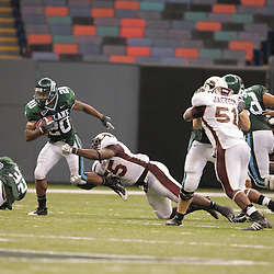 20 September 2008: Tulane wide receiver Jeremy Williams (20) escapes the tackle of Louisiana-Monroe defensive lineman Troy Evans (55) during a Conference USA match up between the University of Louisiana Monroe and Tulane at the Louisiana Superdome in New Orleans, LA.