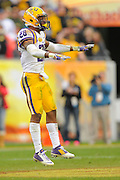 LSU Tigers cornerback Jalen Mills (28) celebrates a defensive play during LSU's 21-14 win over the Iowa Hawkeyes in the 2014 Outback Bowl at Raymond James Stadium on Jan 1, 2014  in Tampa, Florida.            ©2014 Scott A. Miller