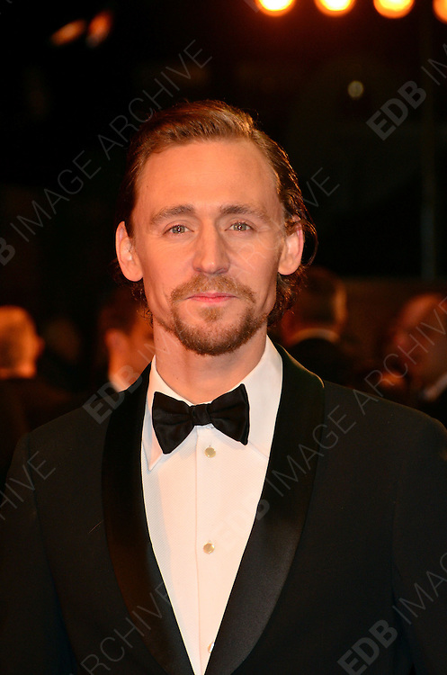 08.JANUARY.2012. LONDON<br /> <br /> TOM HIDDLESTON ARRIVES AT THE WAR HORSE PREMIERE HELD AT THE ODEON LEICESTER SQUARE IN LONDON.<br /> <br /> BYLINE: EDBIMAGEARCHIVE.COM<br /> <br /> *THIS IMAGE IS STRICTLY FOR UK NEWSPAPERS AND MAGAZINES ONLY*<br /> *FOR WORLD WIDE SALES AND WEB USE PLEASE CONTACT EDBIMAGEARCHIVE - 0208 954 5968*