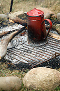 campfire with coffeepot on the fire