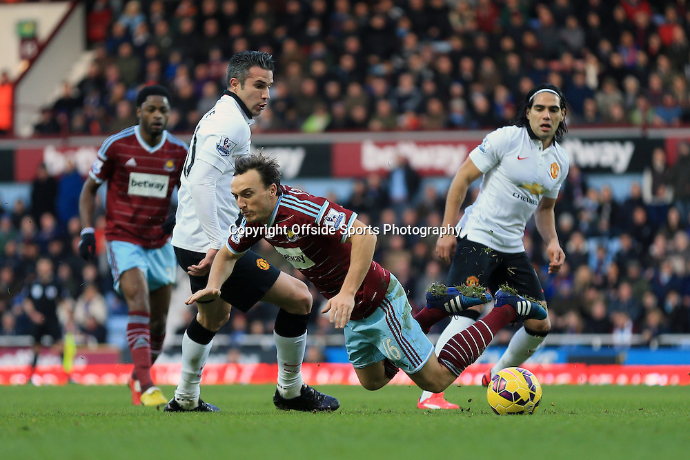 8 February 2015 - Barclays Premier League - West Ham United v Manchester United  Mark Noble of West Ham fouled by Robin van Persie of Manchester United -- Photo: Marc Atkins / Offside.
