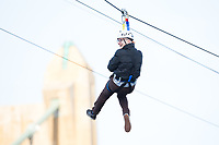 Minneapolis, MN - January 26, 2017: Bold North Zip Line participant zooms down the line and over the Mississippi River as part of the SuperBowl LII events taking place in Minneapolis.