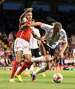 Matt Derbyshire fouling Michael Turner with Rotherham putting pressure on the Fulham box during the Sky Bet Championship match between Fulham and Rotherham United at Craven Cottage, London, England on 15 April 2015. Photo by Matthew Redman.