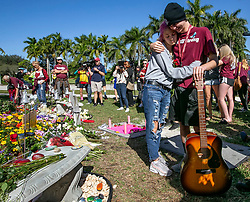 Marjory Stoneman Douglas High students Victoria Gonzalez and Liam Kiernan embrace at a memorial in front of the school Thursday, February 14, 2019, during one year anniversary of the shooting deaths of 17 at Marjory Stoneman Douglas High School in Parkland, FL, USA. Photo by Al Diaz/Miami Herald/TNS/ABACAPRESS.COM