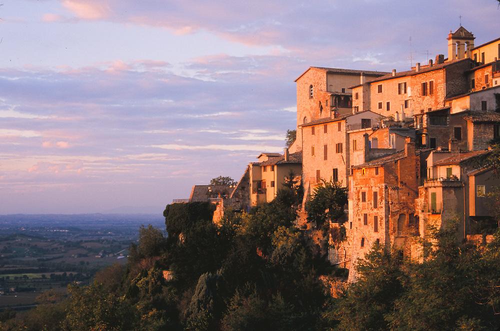 Europe, Italy, Tuscany, Umbria, stone houses on cliff at sunset