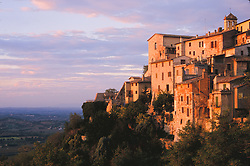 Europe, Italy, Tuscany, Umbria, stone houses on cliff at sunset