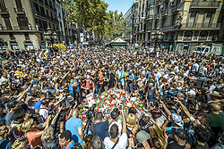 August 18, 2017 - Barcelona, Catalonia, Spain - Thousands gather around a  makeshift memorial on top of a Joan Miro mosaic in Las Ramblas, the site where a van came to a halt after a 550 meter long jihadist terror trip. Thirteen people were killed and almost 80 wounded, 15 seriously, when the van tore through the crowd. (Credit Image: © Matthias Oesterle via ZUMA Wire)