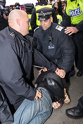 J11 protest.<br /> Police detain a protestor on Piccadilly during the J11 protest in central London by the StopG8 anti-capitalist movement,<br /> London, United Kingdom<br /> Tuesday, 11th June 2013<br /> Picture by Mark  Chappell / i-Images