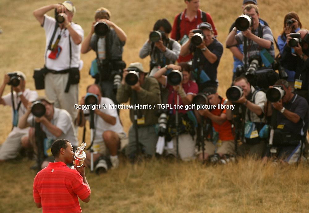Tiger WOODS (USA) kisses the claret jug trophy for the world's media sports photographers during fourth round The Open Championship 2006,Royal Liverpool, Hoylake, Wirral,England.