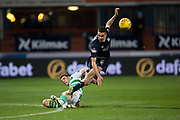 31st October 2018, Kilmac Stadium, Dundee, Scotland; Ladbrokes Premiership football, Dundee v Celtic; Cammy Kerr of Dundee is tackled by Ryan Christie of Celtic