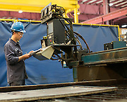 Queen Dinh of Rochester works on a burn table at Klein Steel in Rochester on Thursday, May 28, 2015.