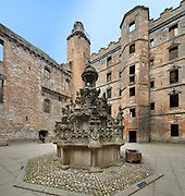 King's fountain, built 1537, in the inner courtyard of Linlithgow Palace, built 15th century under king James I, and rebuilt 1618-22 by king James VI, a royal palace and residence for Scottish monarchs, in West Lothian, Scotland. The fountain was commissioned by James V and is the oldest fountain in Britain. It was restored in 2005. Mary Queen of Scots was born here. The palace was a resting place for Stuart royalty travelling between Edinburgh and Stirling. The Renaissance style palace was burned in 1746 and has since been restored and is now run by Historic Environment Scotland. Picture by Manuel Cohen