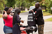 A vendor sells Black Lives Matter tee-shirts near the spot where unarmed black motorist Walter Scott was gunned down by police following a traffic stop April 10, 2015 in Charleston, South Carolina. Scott was shot multiple times in the back and died on the scene after running from police.
