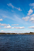 Annadale way, Lochmaben, view over water towards village on a sunny day with a few white clouds