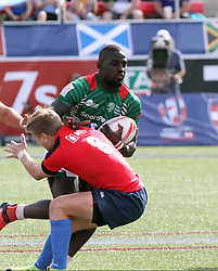 March 5, 2017 - Las Vegas, Nevada, United States of America - Kenyan Samuel Oliech runs past Russian defenders during the 2017 USA Sevens International Rugby Tournament game between Kenya and Russia on March 4, 2017  at Sam Boyd  Stadium  in Las Vegas, Nevada (Credit Image: © Marcel Thomas via ZUMA Wire)