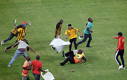 21042018 (Durban) A security official beaten by a mob when violence erupted at the Moses Mabhida Stadium in Durban as angry Kaizer Chiefs fans stormed the pitch and attacked Premier Soccer League security personnel and destroyed property after Steve Komphela's side bombed out of the Nedbank Cup following a 2-0 defeat at the hands of Free State Stars on Saturday April 21 2018.<br /> Picture: Motshwari Mofokeng/ANA