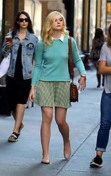 Elle Fanning sports two wardrobe changes while Liev Schreiber brought one of his rescue dogs to the set for the upcoming Woody Allen Summer Project filming in Midtown Manhattan. 15 Sep 2017 Pictured: Elle Fanning. Photo credit: LRNYC / MEGA TheMegaAgency.com +1 888 505 6342