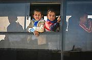 Children on a school bus in Gaza City.