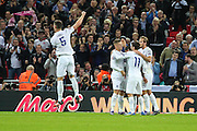 England's captain Gary Cahill shows his delight after Theo Walcott puts England 1 nil up during the UEFA European 2016 Qualifier match between England and Estonia at Wembley Stadium, London, England on 9 October 2015. Photo by Shane Healey.