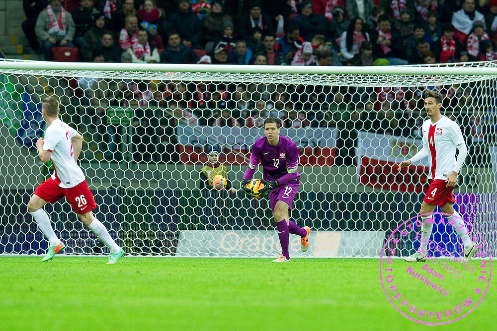 (C) Poland's goalkeeper Wojciech Szczesny controls the ball during international friendly soccer match between Poland and Scotland at National Stadium in Warsaw on March 5, 2014.<br /> <br /> Poland, Warsaw, March 5, 2014<br /> <br /> Picture also available in RAW (NEF) or TIFF format on special request.<br /> <br /> For editorial use only. Any commercial or promotional use requires permission.<br /> <br /> Mandatory credit:<br /> Photo by &copy; Adam Nurkiewicz / Mediasport