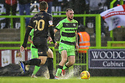 Forest Green Rovers Carl Winchester(7) runs forward during the EFL Sky Bet League 2 match between Forest Green Rovers and Mansfield Town at the New Lawn, Forest Green, United Kingdom on 15 December 2018.