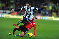 West Brom's Morgan Amalfitano is fouled by Cardiff's Gary Medel. Barclays Premier league, Cardiff city v West Bromwich Albion at the Cardiff city Stadium in Cardiff, South Wales on Saturday 14th Dec 2013. pic by Andrew Orchard, Andrew Orchard sports photography.