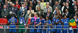 LONDON, ENGLAND - Saturday, May 17, 2008: Portsmouth's goalkeeper David James lifts the trophy as his team-mates celebrate winning the cup after beating Cardiff City 1-0 during the FA Cup Final at Wembley Stadium. (Photo by Chris Ratcliffe/Propaganda)