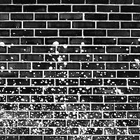 Paint splattered on brick wall