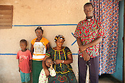 (From left to right) Moussa, 5, Maimouna, 11, and Awa, 3, pose for a photograph with their parents Maka, 33, and Toumari, 38, outside their family home in Duékoué, western Côte d'Ivoire.<br /> Maimouna had been separated from her family for three months, since the moment armed conflict broke out in her hometown, Duékoué, and she had to flee to Man. Save the Children facilitated the reunion with her parents and her return home.