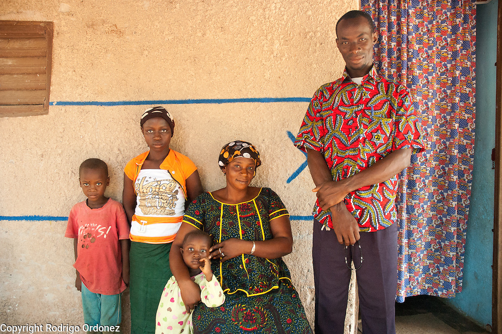 (From left to right) Moussa, 5, Maimouna, 11, and Awa, 3, pose for a photograph with their parents Maka, 33, and Toumari, 38, outside their family home in Du&eacute;kou&eacute;, western C&ocirc;te d'Ivoire.<br /> Maimouna had been separated from her family for three months, since the moment armed conflict broke out in her hometown, Du&eacute;kou&eacute;, and she had to flee to Man. Save the Children facilitated the reunion with her parents and her return home.