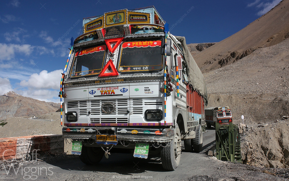 Indian truck climbs the Himalayas as it negotiates the hazardous road to Pang, Ladakh, Northern India