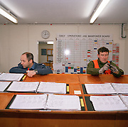 Engineering ground staff of the Red Arrows, Britain's RAF aerobatic team, await pilots to sign flight manuals before  flight
