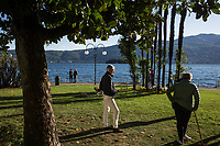 VERBANIA, ITALY - 18 APRIL 2017: People play cricket by the Lake Maggiore in Verbania, Italy, on April 18th 2017.<br /> <br /> Emma Morano was an Italian supercentenarian who, prior to her death at the age of 117 years and 137 days, was the world's oldest living person whose age had been verified, and the last living person to have been verified as being born in the 1800s. She died on April 15th 2017.