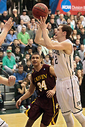14 March 2014:  Jordan Daley & Dylan Overstreet during an NCAA mens division 3 quarter final basketball game between the Calvin Knights and the Illinois Wesleyan Titans in Shirk Center, Bloomington IL