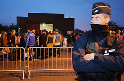 "Migrants line-up to register at a processing centre in ""the jungle"" near Calais, northern France, as the mass exodus from the migrant camp begins."