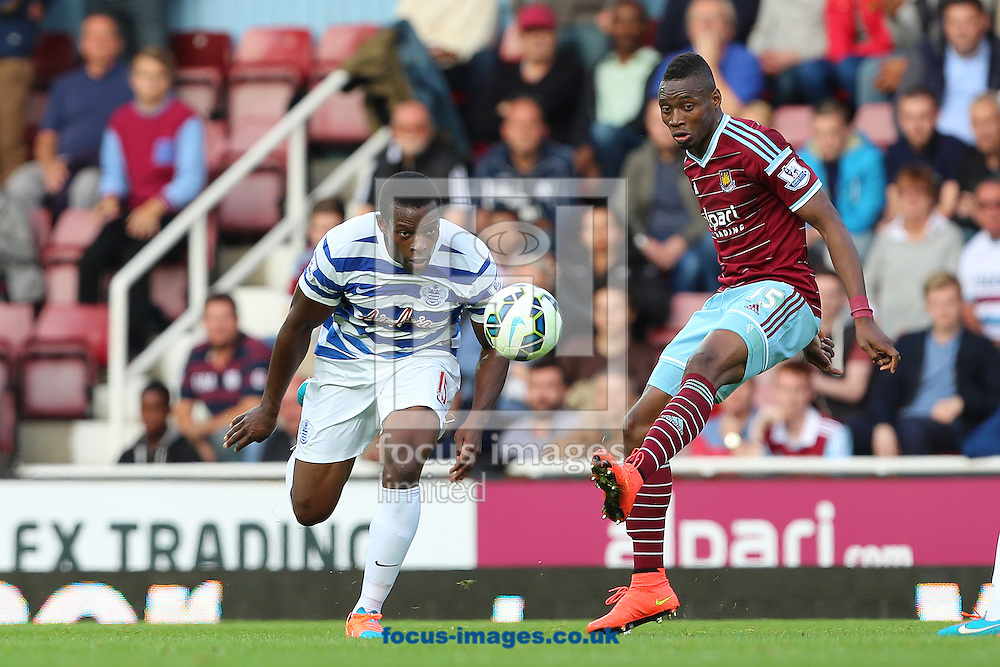 Diafra Sakho of West Ham United and Nedum Onuoha of Queens Park Rangers during the Barclays Premier League match at the Boleyn Ground, London<br /> Picture by Richard Calver/Focus Images Ltd +447792 981244<br /> 05/10/2014