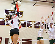 Maquoketa's Aubree Taylor (8) goes up for a kill over Beckman's Danielle Kennedy (10) and Brooke Klostermann (12) during the WaMaC Tournament semifinal game at Mount Vernon High School in Mount Vernon on Thursday October 11, 2012. Maquoketa defeated Dyersville Beckman 25-16, 25-20.